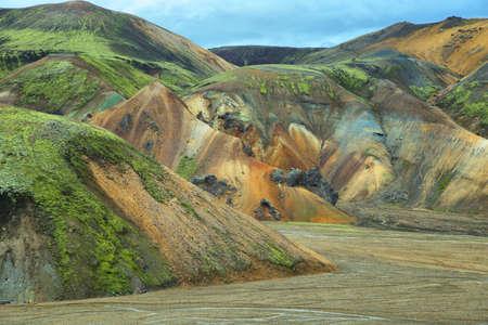 Multicolored rhyolite mountains of Landmannalaugar, Iceland photo