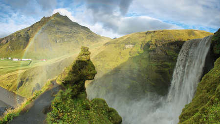 brink: Unusual profile view of Skogarfoss waterfall, Iceland.