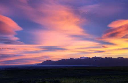 fjallsarlon: Sunrise near Fjallsarlon Glacial Lagoon with majestic lenticulars clouds, Iceland