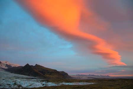 fjallsarlon: Sunrise at Fjallsarlon Glacial Lagoon of Vatnajokull glacier with majestic lenticulars clouds, Iceland