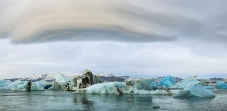lenticular: Jokulsarlon Glacial Lagoon of Vatnajokull glacier under majestic lenticular clouds, Iceland