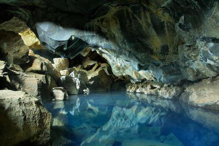 Underground hot spring Grjotagja in Iceland 免版税图像
