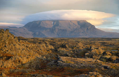 lenticular: View of lenticular clouds over a mountain near Myvatn, Iceland Stock Photo