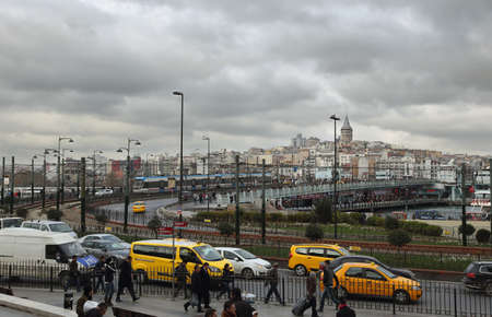 hectic: ISTANBUL, TURKEY - NOVEMBER 27: View of the hectic daily life, yellow cabs and famous Galata Bridge on November 27, 2014 in the historical center of Istanbul, Turkey.
