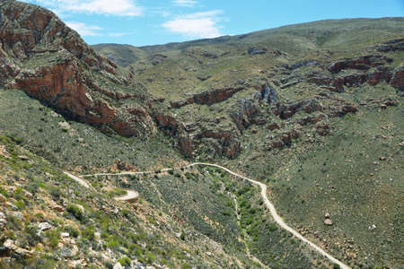 inhospitable: Winding road and gorge in Swartberg pass, South Africa Stock Photo