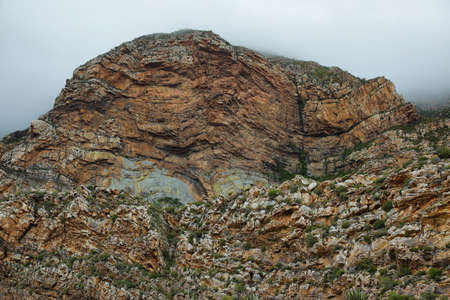 inhospitable: Majestic rocky redish mountains in Seweweekspoort pass, South Africa