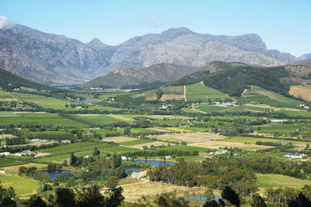 Landscape of plantation fields and mountains from Franschhoek Pass, South Africa