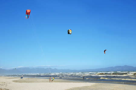 kiter: MUIZENBERG, SOUTH AFRICA - DECEMBER 5: Kite surfers training a day with strong winds on December 5, 2014 in Muizenberg beach, South Africa
