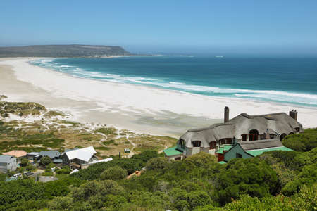big house: View of Noordhoek Beach from Chapmans Peak Drive on the Cape Peninsula near Cape Town, South Africa. Stock Photo