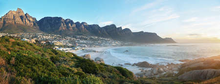 apostles: Camps Bay Beach in Cape Town, South Africa, with the Twelve Apostles in the background. Stock Photo