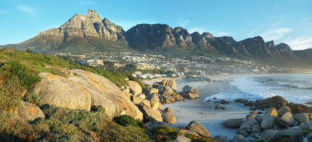 bay: Camps Bay Beach in Cape Town, South Africa, with the Twelve Apostles in the background. Stock Photo