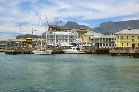 capetown: CAPE TOWN,SOUTH AFRICA-DECEMBER, 29:Victoria and Alfred Waterfront, harbor with recreation boats, shops, restaurants and Table Mountain on background on December 7, 2014  in Cape Town, South Africa.