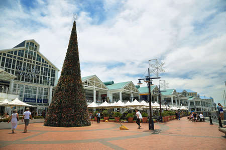 capetown: CAPE TOWN, SOUTH AFRICA-DECEMBER 7: Entrance of Victoria Wharf Shopping Centre with a big Christmas tree on December 7, 2014 in V&A Waterfront of Cape Town, South Africa. Editorial