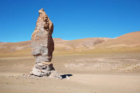 high plateau: Geological monolith Known as Monjes de la Pakana close to Salar Aguas Calientes, Atacama desert, Chile Stock Photo