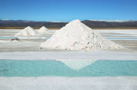 salt flat: Salt piles and water pool on Salinas Grandes salt flats in Jujuy province, northern Argentina.