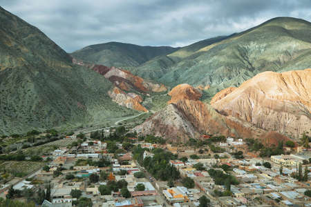 Multicolored mountains known as Cerro de los 7 colores (hill of seven colors) in Purmamarca at sunrise, Jujuy province, Argentina Standard-Bild