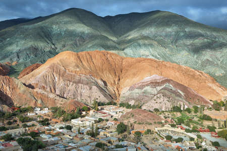 colores: Multicolored mountains known as Cerro de los 7 colores (hill of seven colors) in Purmamarca at sunrise, Jujuy province, Argentina Stock Photo