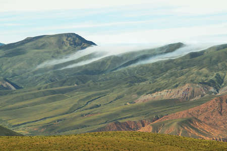 redish: Clouds over valley near place known as Serrania del Hornocal, Jujuy province, Argentina