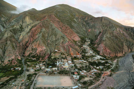 mountainscape: View of Iruya village and multicolored mountains in the surroundings at sunset, Salta province, Argentina