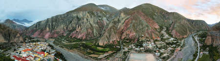 isidro: View of Iruya village and multicolored mountains in the surroundings at sunset, Salta province, Argentina