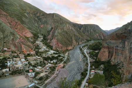 puna: View of Iruya village and multicolored mountains in the surroundings at sunset, Salta province, Argentina