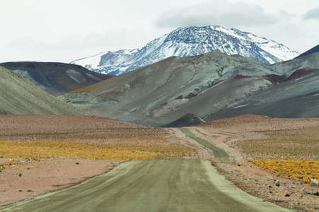 high plateau: View of road and mountains in Sico Pass on the way to San Pedro de Atacama, Chile Stock Photo