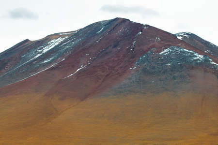 high plateau: View of mountain with red colors in Sico Pass, Chile Stock Photo