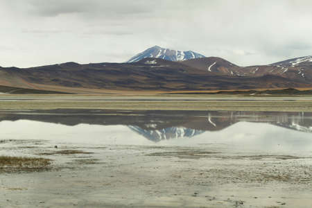 high plateau: View of mountains and Aguas calientes  or Piedras rojas salt Lake in Sico Pass, Chile
