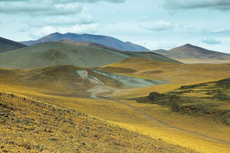 high plateau: View of mountains and dirt road in Sico Pass, Chile Stock Photo