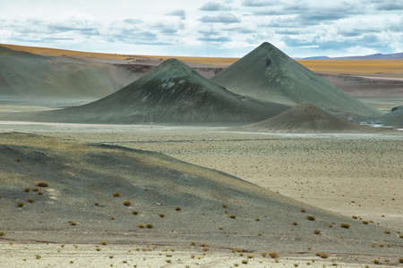 high plateau: Curious pyramidal formations in Sico Pass on the way to San Pedro de Atacama, Chile