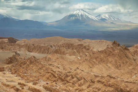 Desert landscape of Valley of Mars with Licancabur peak at background- Atacama Desert - Chile
