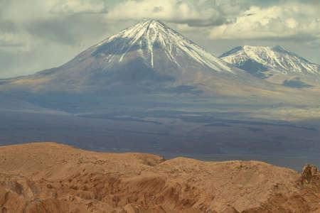 Desert landscape of Valley of Mars with Licancabur peak at background- Atacama Desert - Chile