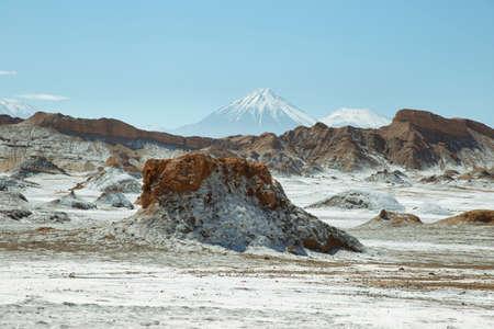 Desert landscape of Valley of the Moon with Licancabur peak at background- Atacama Desert - Chile