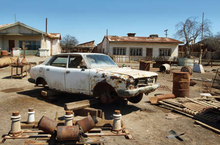 urban decline: HUMBERSTONE, CHILE - APRIL 14: Ruin of old car in the UNESCO World Heritage ghost town of Humberstone on April 14, 2015 in Chile