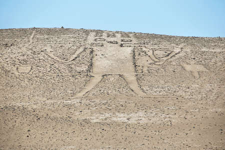 Ancient giant geoglyph known as Atacama giant and located at Cerro Unitas in Pampa del Tamarugal, Chile Imagens