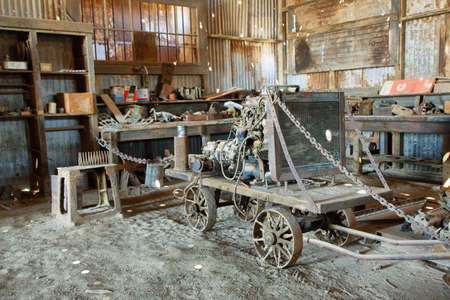 urban decline: HUMBERSTONE, CHILE - APRIL 14: Old equipment and tools inside a building of the UNESCO World Heritage ghost town of Humberstone on April 14, 2015 in Chile