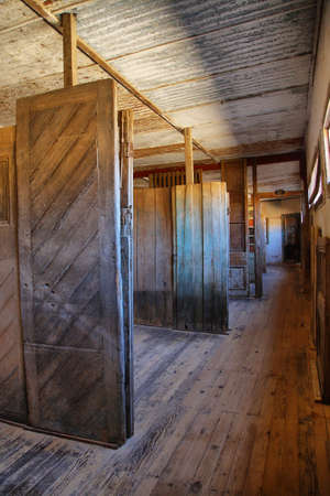 ruinous: HUMBERSTONE, CHILE - APRIL 14: Old doors exhibition of the UNESCO World Heritage ghost town of Humberstone on April 14, 2015 in Chile Editorial
