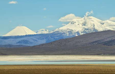 high plateau: Smoky Guallatiri volcano from Salar de Surire national park, Chile