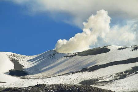 high plateau: Cone of smoky volcano isluga, Chile