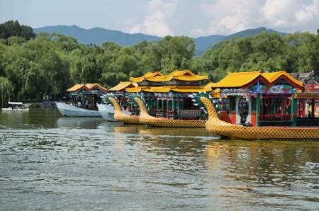 yellow boats: Yellow dragon boats at the summer palace in Beijing, China Editorial