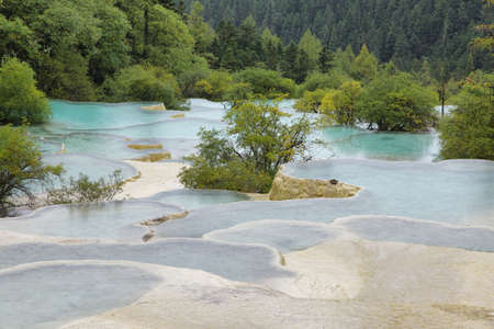 calcite: Flamboyant Pond in Huanlong scenic Area, Unesco world heritage site in Sichuan Province, China