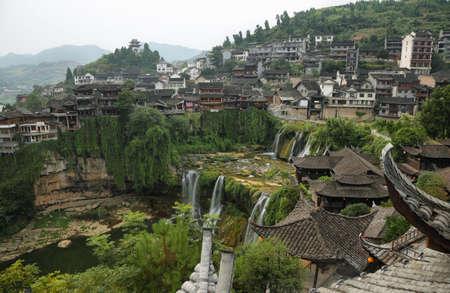 province: Furong (Hibiscus) ancient village and its waterfall Hunan province, China.