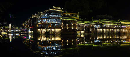 house float on water: View of illuminated Wanming Pagoda in Fenghuang, China