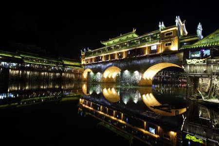 pavillion: View of illuminated Rainbow bridge in Fenghuang, China