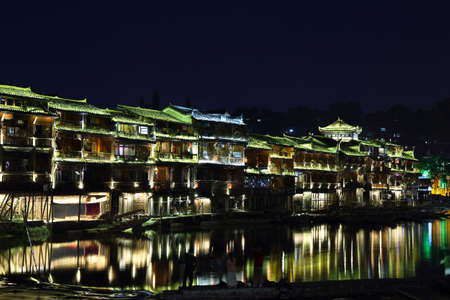 chinese phoenix: View of illuminated riverside houses in Fenghuang, China