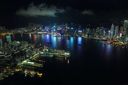 icc: HONG KONG, CHINA - SEPTEMBER 23, 2015: Skyline of the skyscrapers illuminated at sunset from 100 floor of ICC building in Hong Kong.