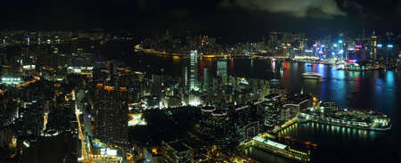 ifc: HONG KONG, CHINA - SEPTEMBER 23, 2015: Skyline of the skyscrapers illuminated at sunset from 100 floor of ICC building in Hong Kong.