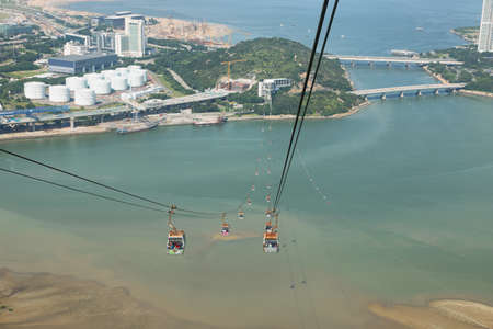 ravel: Aerial view of cablecar and landscape in Lantau island from Ngong ping 360 cable car, Hong kong