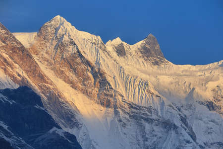 High peak at sunrise from Annapurna base camp sanctuary, Nepal Stock Photo