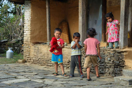 end of the trail: DHAMPUS, NEPAL - APRIL 20, 2016: nepalese kids playing in Damphus village near the end of Annapurna base camp hiking trail in Nepal Editorial